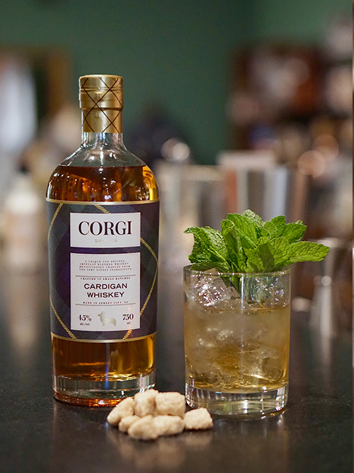 MINT JULEP   2 oz Corgi Spirits Cardigan Whiskey  1 oz sweet vermouth  2 dashes Angostura bitters  1 dash orange bitters    Add all the ingredients into a mixing glass with ice, and stir until well-chilled. Strain into a chilled coupe. Garnish with a brandied cherry.