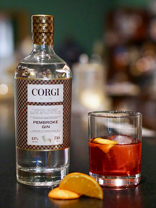 NEGRONI   1 oz Corgi Spirits Pembroke Gin  1 oz Campari  1 oz sweet vermouth  Orange peel for garnish    Fill a mixing glass with ice, add all ingredients and stir thoroughly until well chilled. Strain over one large ice cube in a rocks glass. Garnish with an orange peel, expressing the oils over the top of the drink.