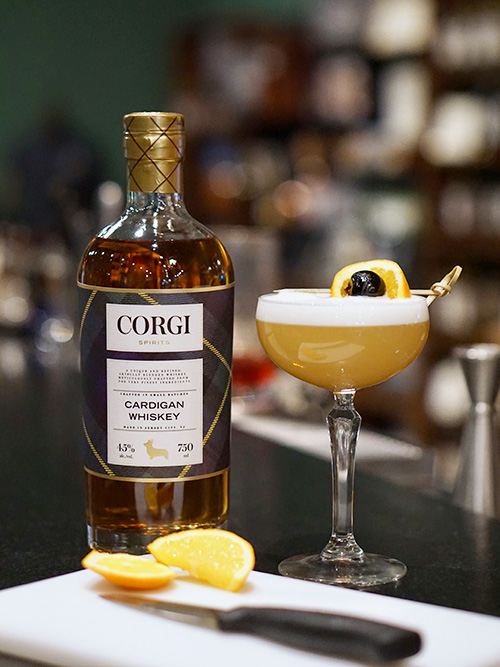 WHISKEY SOUR   2 oz Cardigan Whiskey  .75 oz fresh lemon juice  .75 oz simple syrup  1 small egg white  Add all ingredients to a cocktail shaker, and dry shake. Add ice to the shaker and shake well. Strain into a chilled coupe or cocktail glass or over ice into a rocks glass.