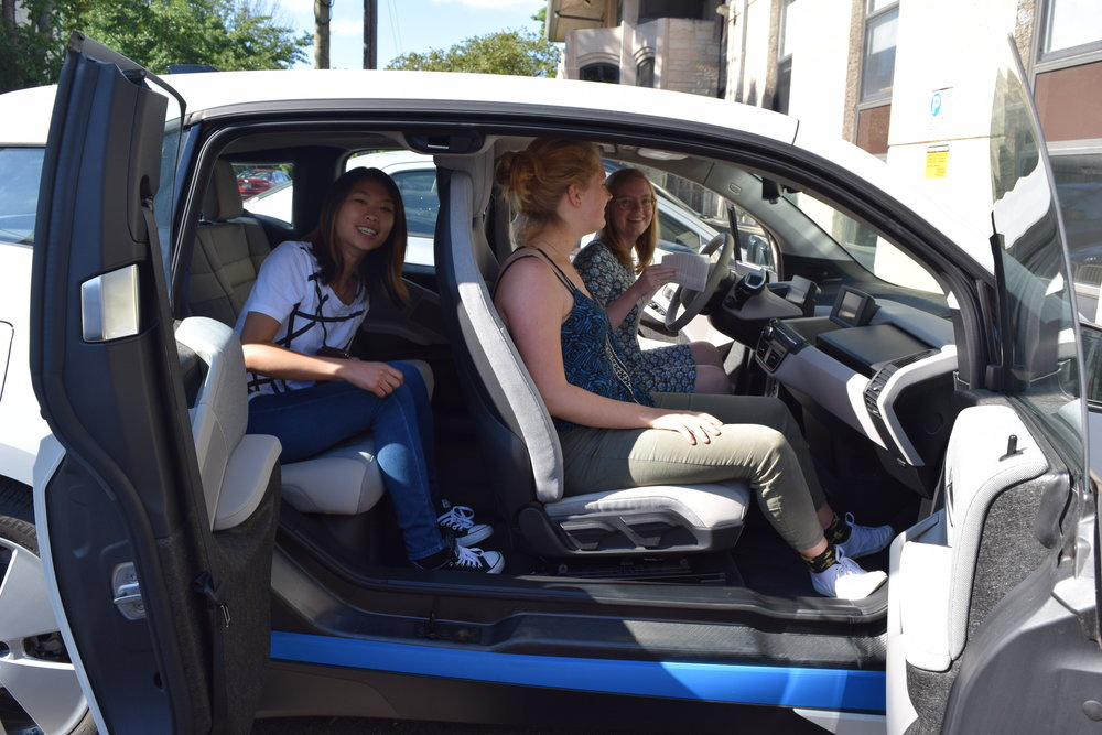 The HBN team has fun with its new BMW i3 electric vehicle.