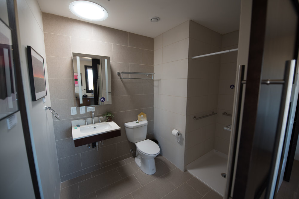 ADA-compliant bathroom for the convertible room. Photo credit: Monika Wnuk