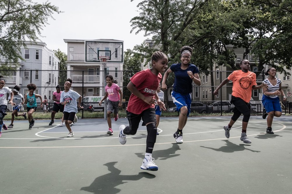 G3 Summer Clinic - Shooting Touch's G3 Program is pleased to announce our free annual Summer Clinic in partnership with the Boston Police Department.The camp will run from July 9-12 from 9am-1pm at the Wainwright Park in Dorchester.Registration is open to 3-10th grade females.The camp will feature basketball workouts, health education, guest speakers, female empowerment activities, games and more! The basketball workouts will consist of basic skills and drills for beginners, elite training for advanced players and scrimmages.Each day will feature an enrichment component that emphasizes health, wellness or empowerment.Officers from the Boston Police Department will be in attendance each day, coaching the girls and building relationships. The last day of the clinic features the highly anticipated G3 VS BPD rematch (G3 won last summer)!For questions please contact Kash Cannon: Kcannon@shootingtouch.com.