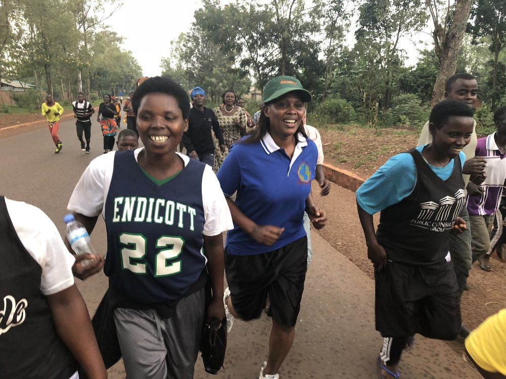 Jackie running with other Shooting Touch Women to celebrate International Women's Day