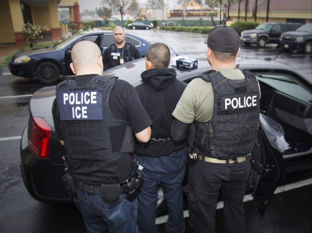 A man is arrested by Immigration and Customs Enforcement agents Feb. 7 during a targeted enforcement operation. (Charles Reed/U.S. Immigration and Customs Enforcement via AP)