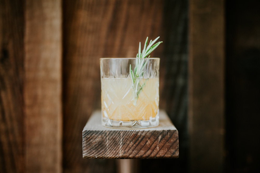 image by  Ryan Chard Smith    SUMMER SMASH   2 oz. whiskey  0.75 oz.  ROSEMARY SYRUP   0.75 oz. lemon juice  Shake all ingredients in a cocktail shaker filled with ice. Strain into a rocks glass with fresh ice. Garnish with a rosemary sprig.