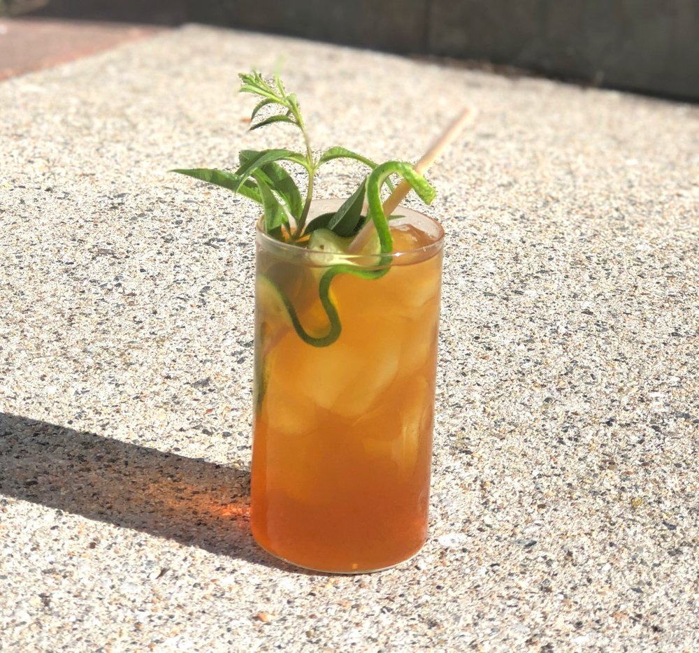 GOLDEN BEAR HERBAL TEA   5 oz. herbal tea, like Mint, Chamomile, Lemon Verbena, or Ginger.  1 oz.  TONIC SYRUP   1 slice of lemon and lime  Add all ingredients to a glass filled with ice. Garnish with a fresh herb and citrus slices.