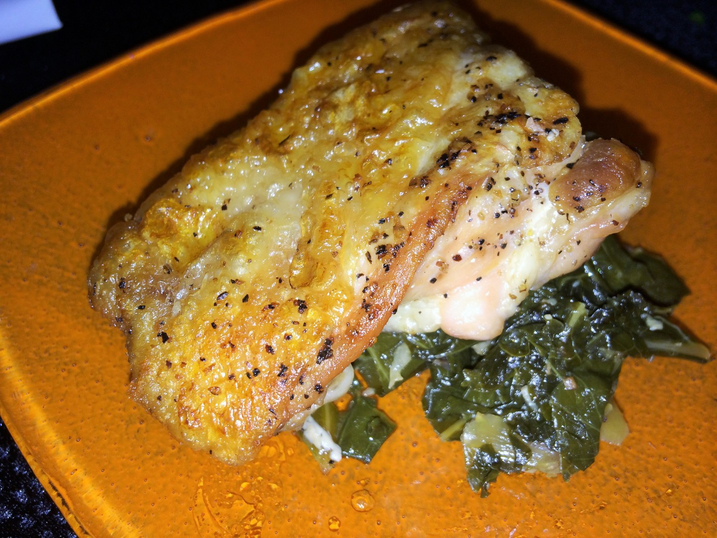 "Griddled ""Yard Bird"" with braised greens and housemade habanero sauce"