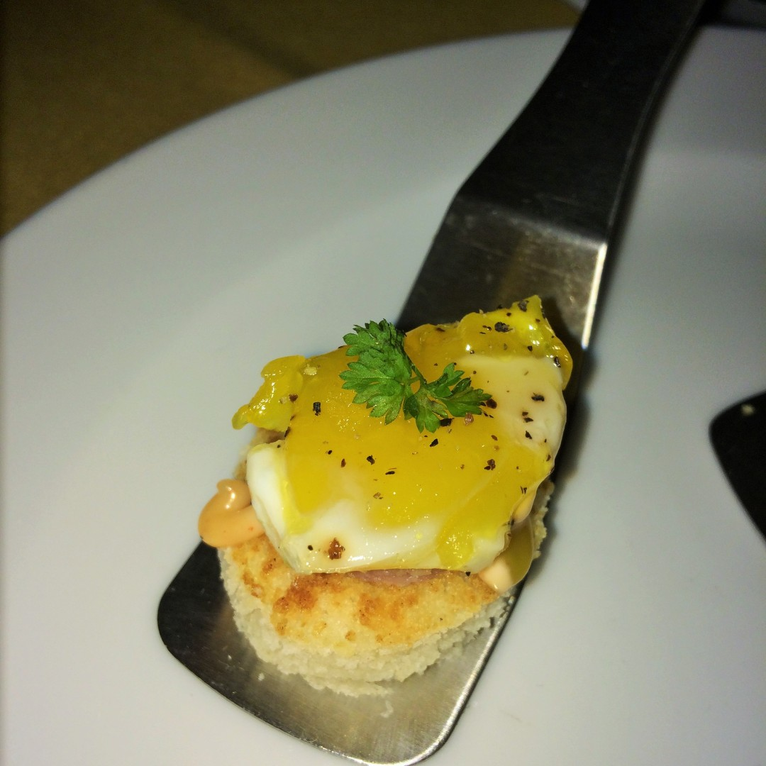 Charred Spam and quail egg on a biscuit with honey aioli