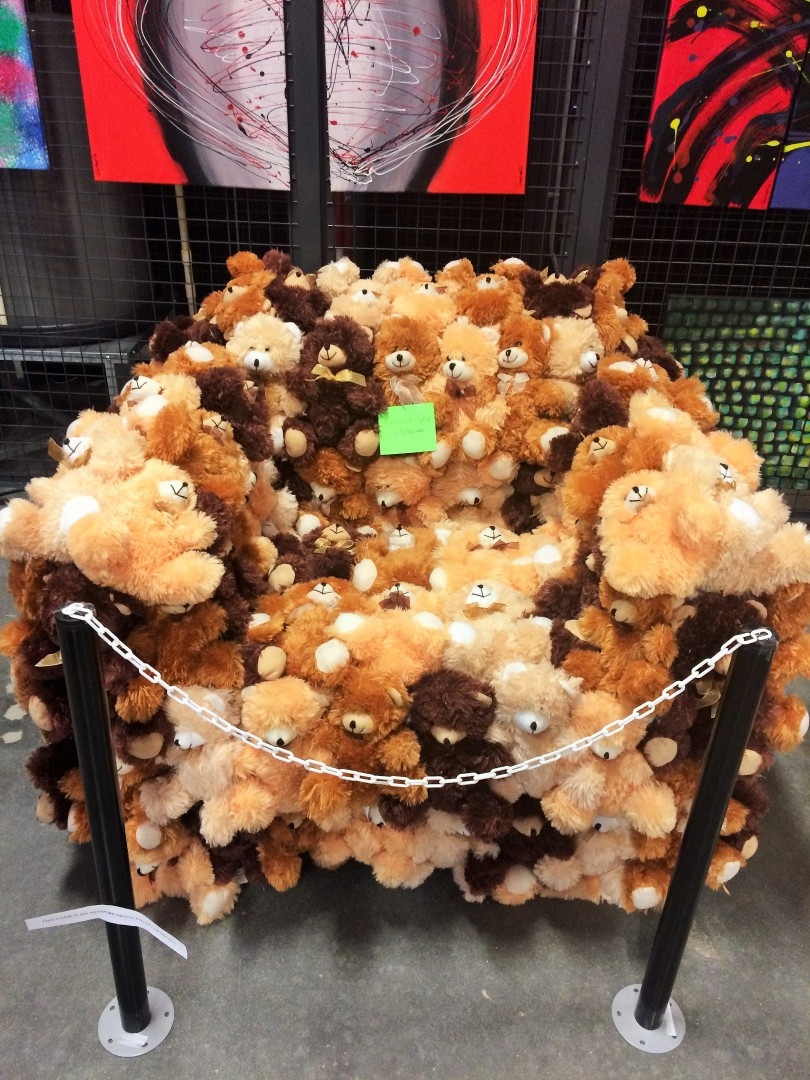 A chair made of stuffed bears
