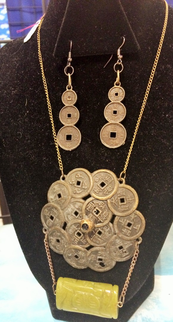 Here's a coin-ish necklace with earrings from Krap Art.