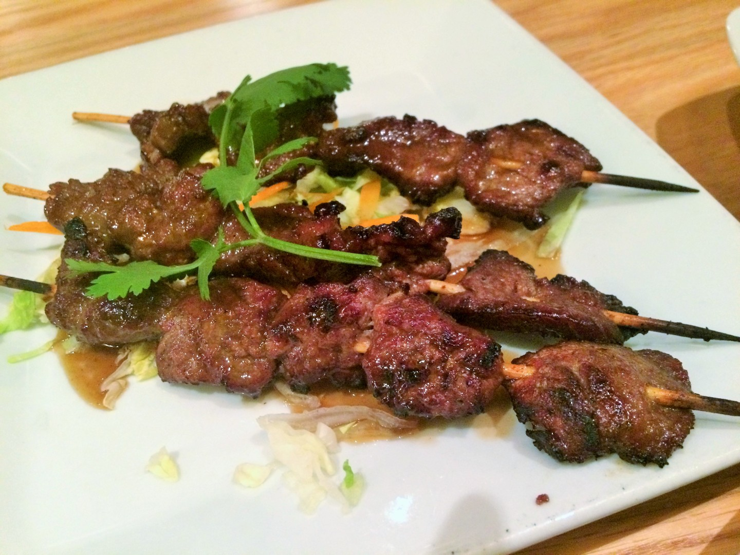 Korean bulgogi beef skewers at Mamak, a restaurant featuring Asian street food. Why is Mamak so much like Hawkers?
