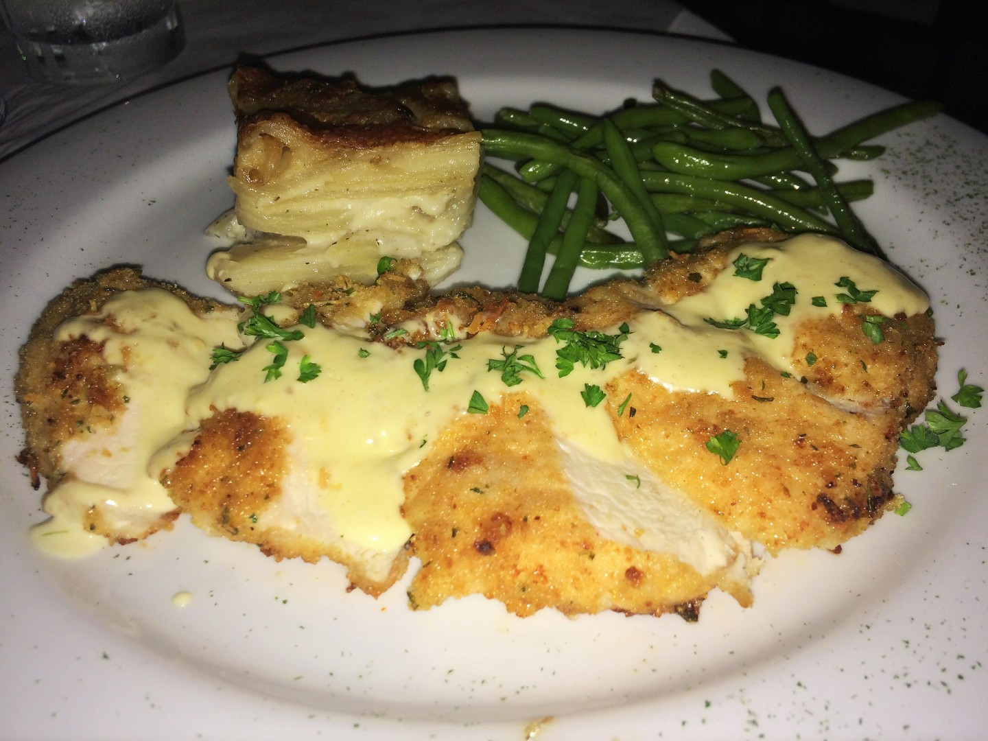 Parmesan-crusted chicken Dijon is a star on the new seasonal menu at Paris Bistro