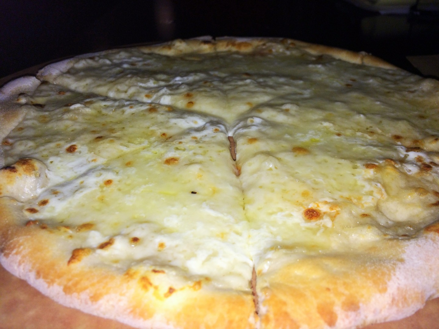 Three-cheese pizza with asiago, pecorino, and fontina, plus truffle cream.