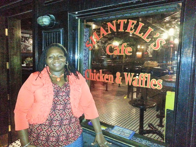 Here's Shantell, welcoming guests to  her soul food restaurant.