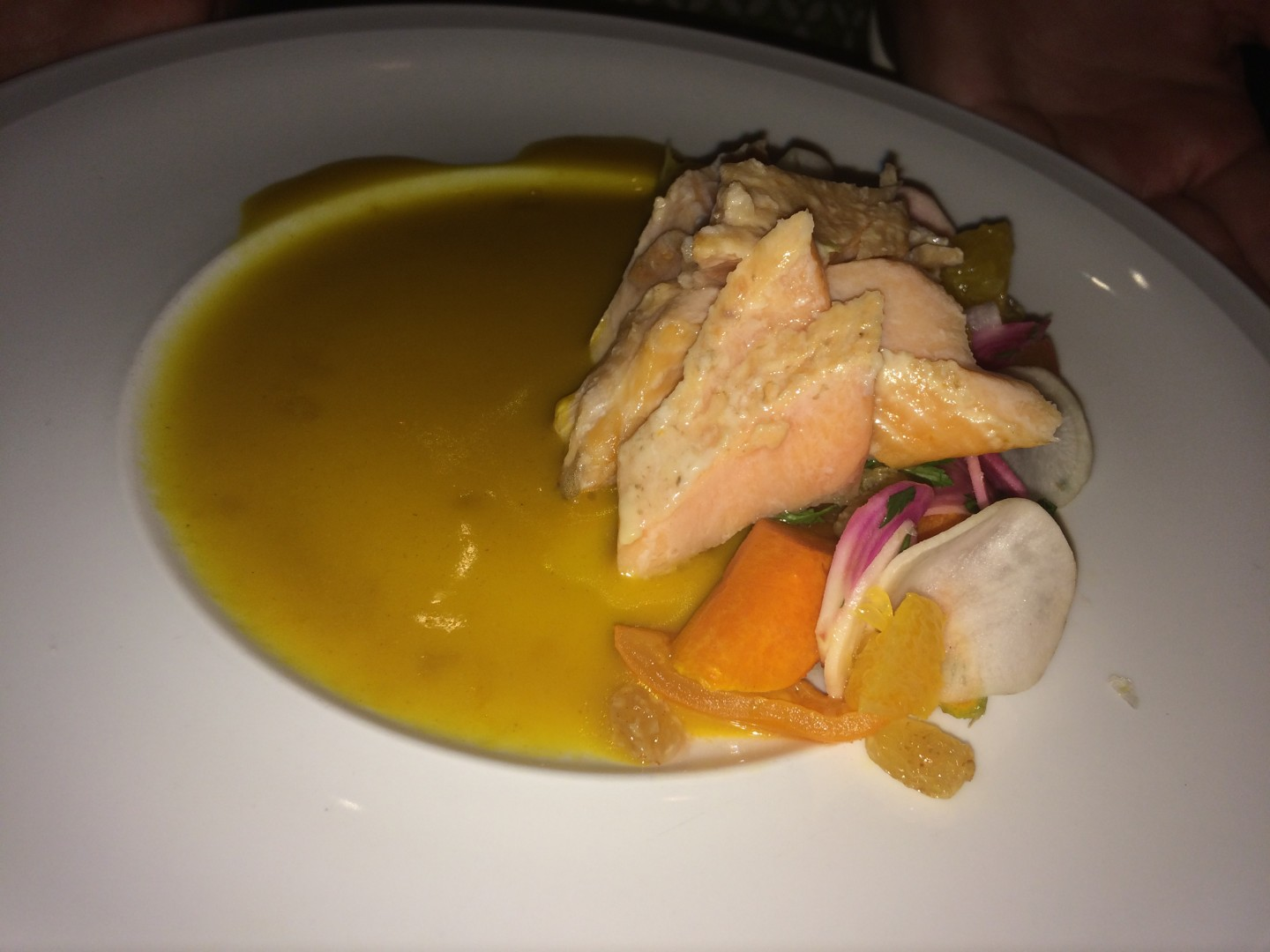 Arctic char with carrot dashi, mirin-cured beets, heirloom carrots, and dill flower