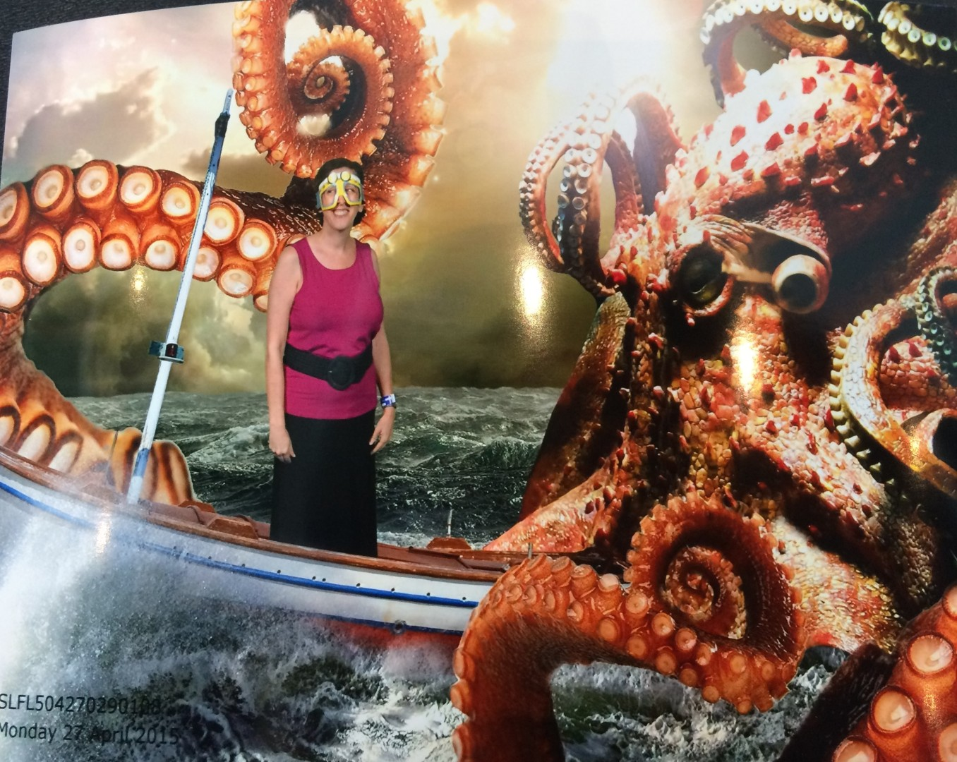 This photo (silly cardboard mask provided by staff) was taken in front of a green screen, then digitally transposed to incorporate this kraken sea monster.