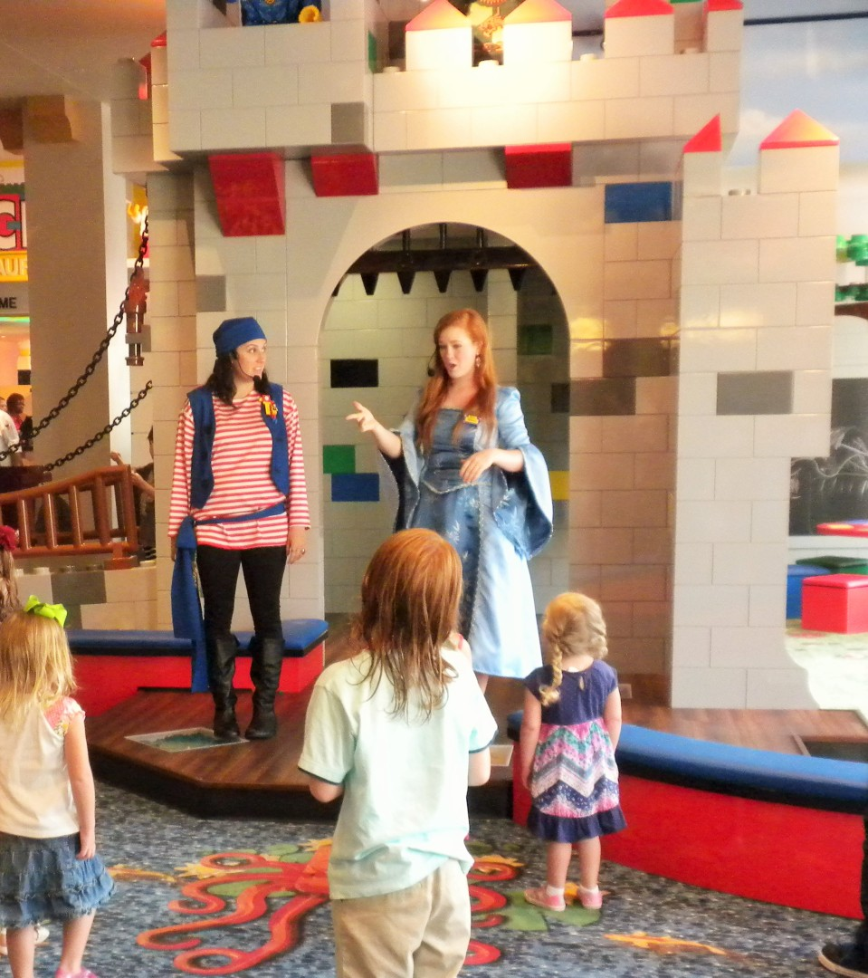 Characters interact with children at the lobby castle.