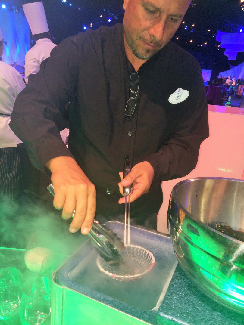 A cast member makes The Smoking Hibiscus, using Montelobos Mezcal Joven.