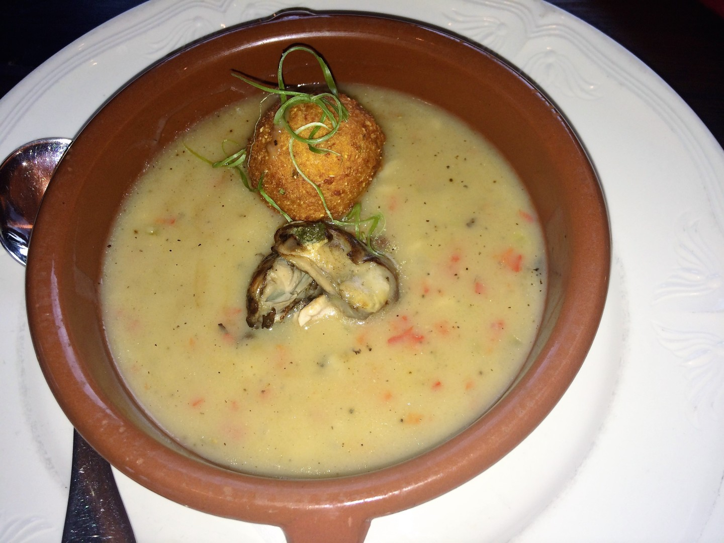 Smoked oyster stew with orange brandy and sweet potato hush puppy