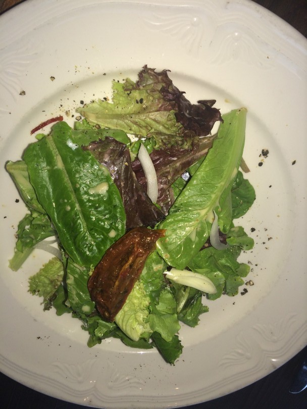 Market salad with local greens, smoked tomato confit, toasted cumin seed, and buttermilk vinaigrette