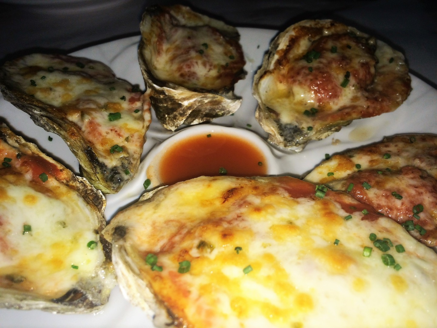 Oysters on Fire --baked oysters with a habanero red sauce and Monterey pepperjack cheese