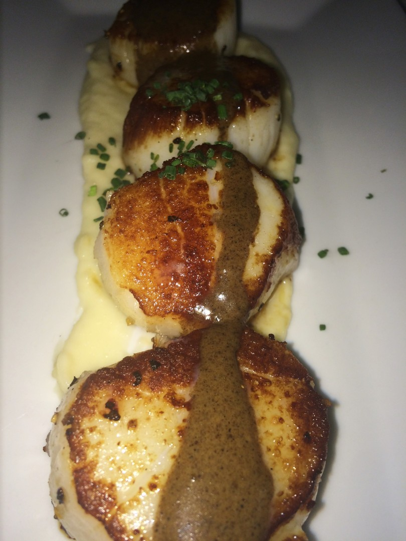 Sea scallops with parsnip puree and porcini coulis at Two Chefs Seafood