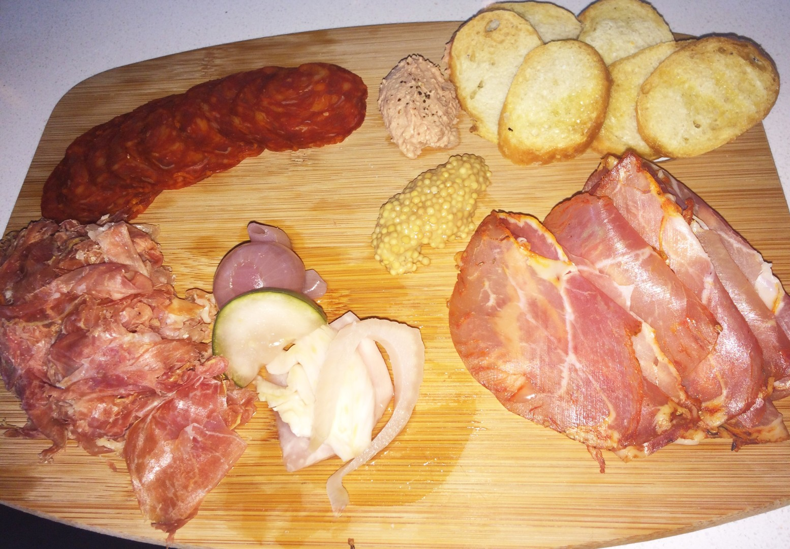 Embutidos, a charcuterie platter. The chorizo, in the top left, is the real deal, the slice-and-nibble sausage imported from Spain. Also pictured: chicken pate, pickled mustard seeds, house-pickled vegetables, jamon Serrano,and lomo.