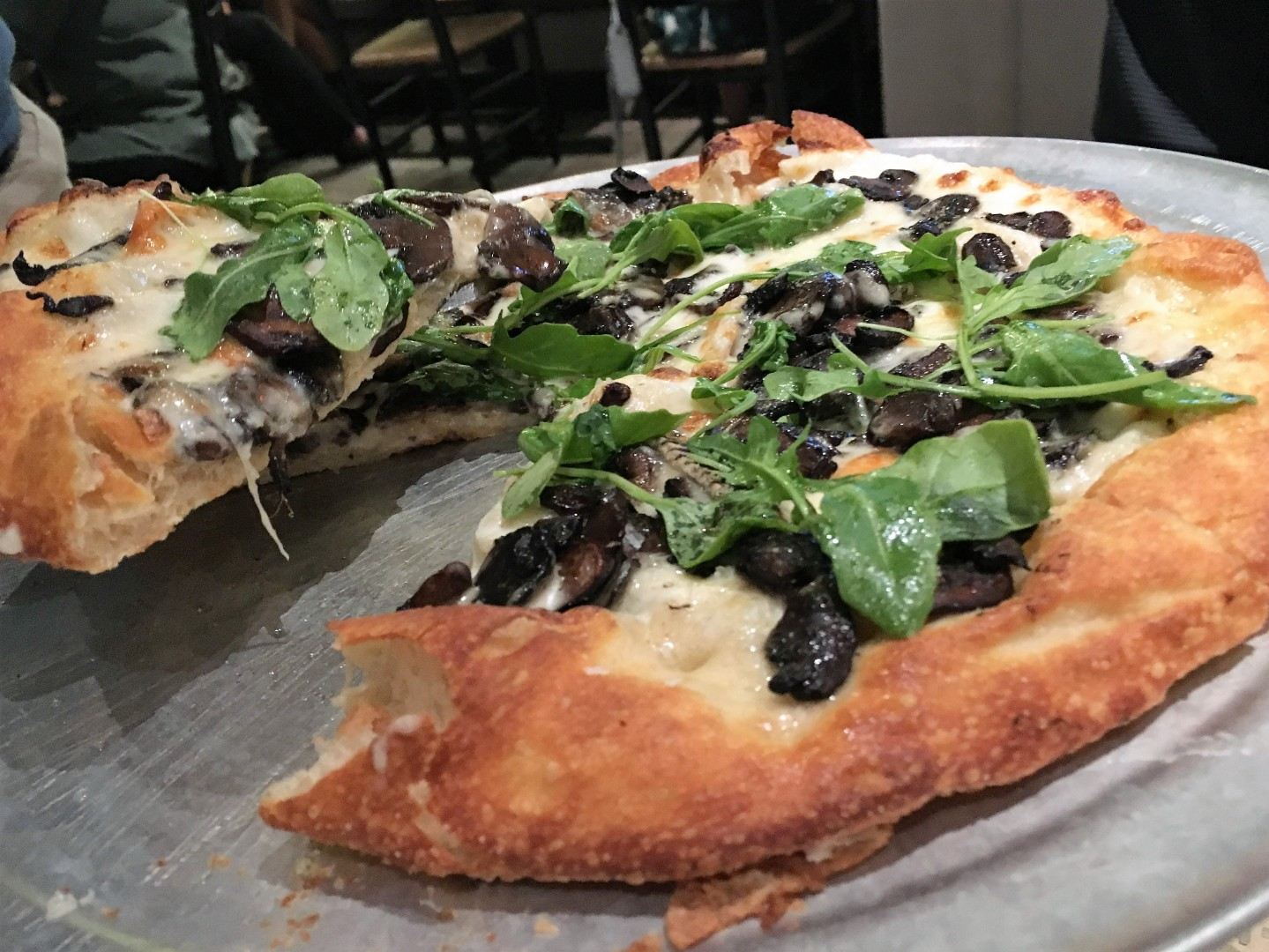 Fungi pizza with crimini mushrooms, Taleggio and roasted garlic oil