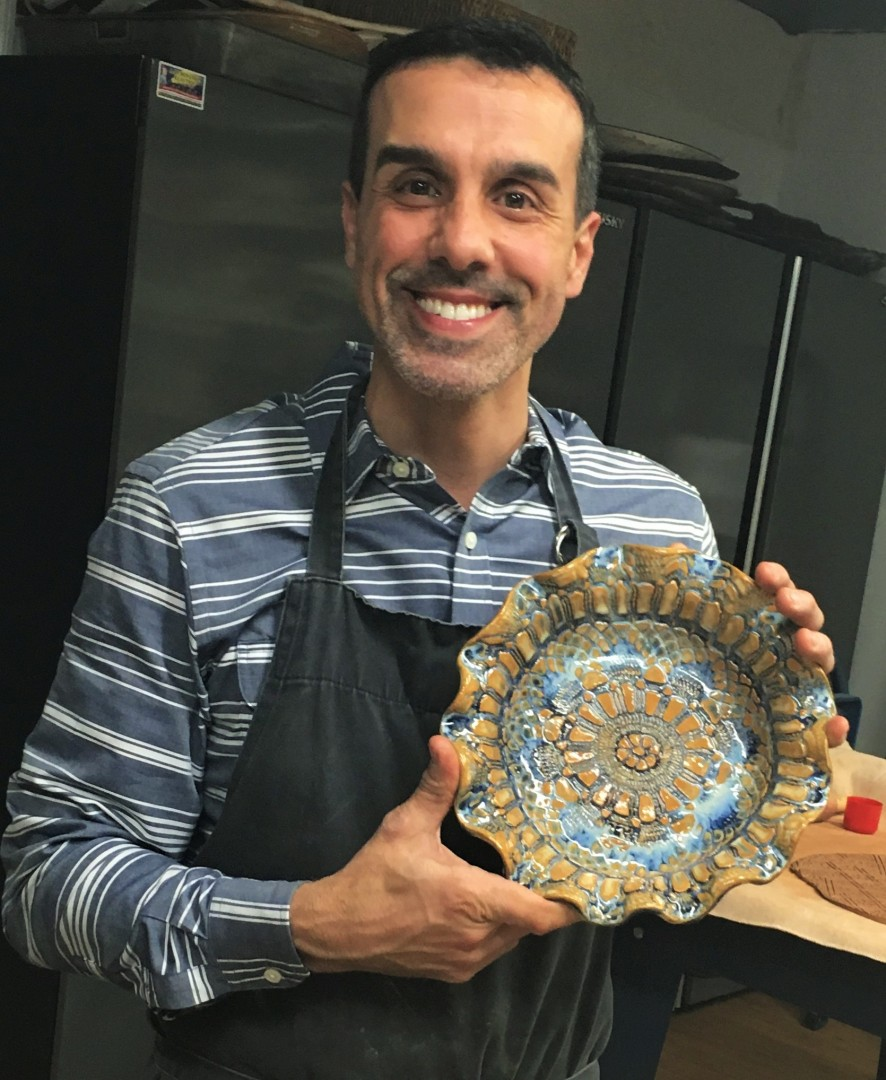 Fabian Pesci, holding one of his creations.