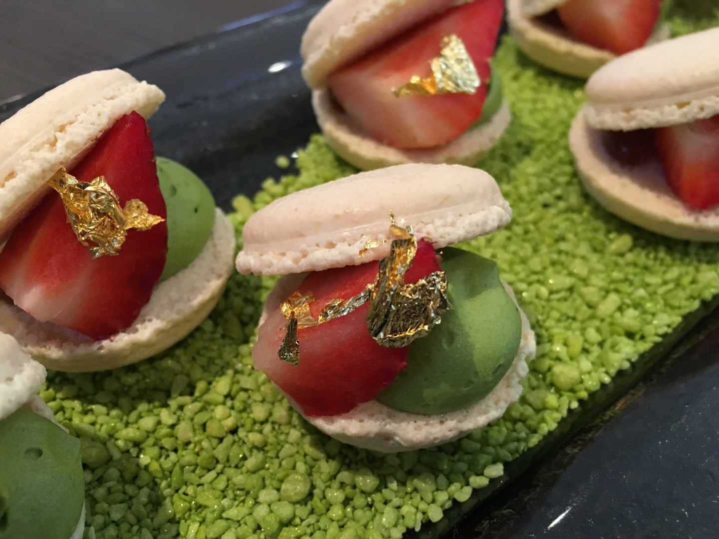 Open-facae macaron with green tea ice cream and raspberry jelly