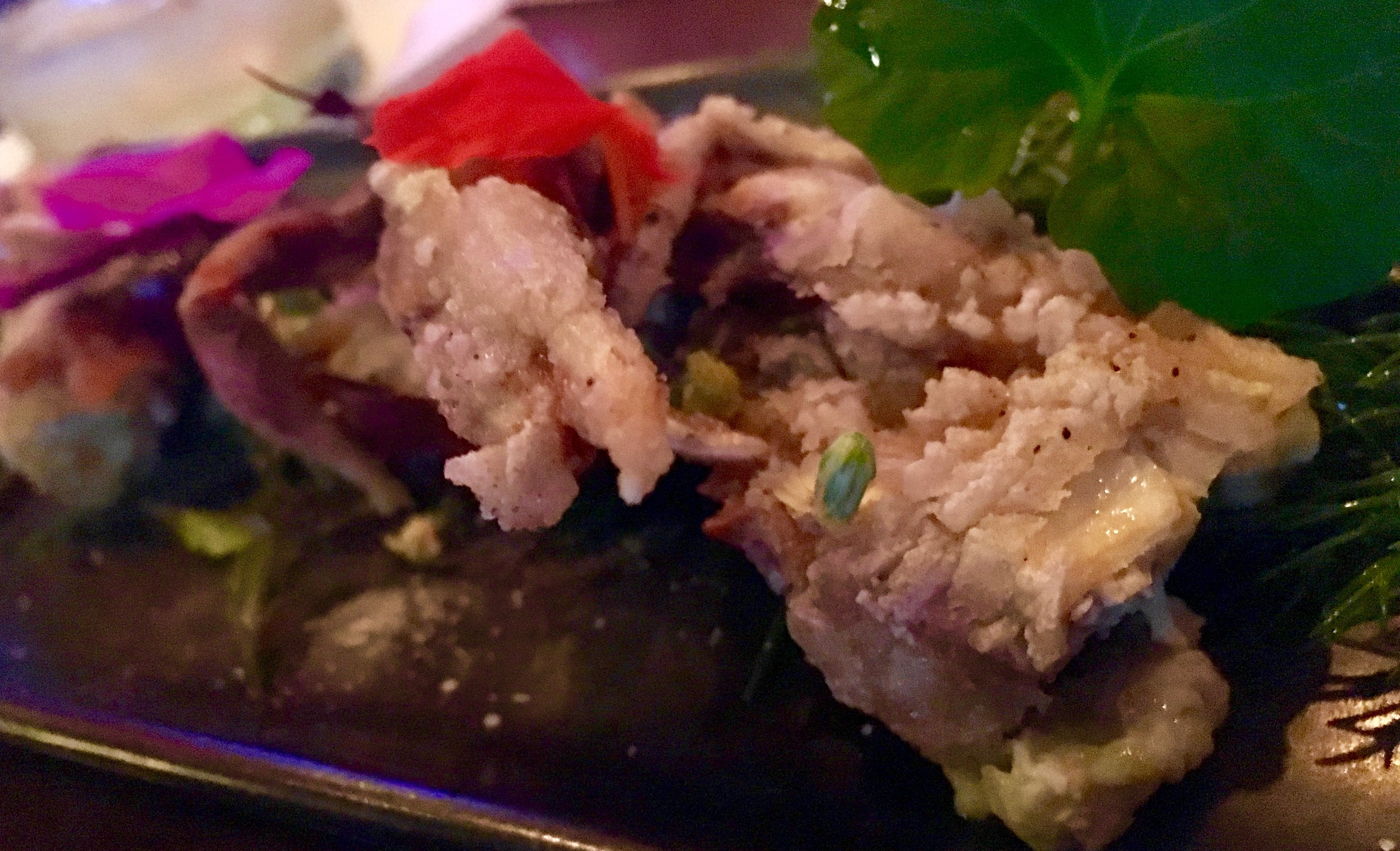 Salt-and-pepper softshell crab with herb salad from the Seito Sushi garden, nuc cham dressing, garden peppers and purple snow peas at the omakase dinner at Seito Sushi