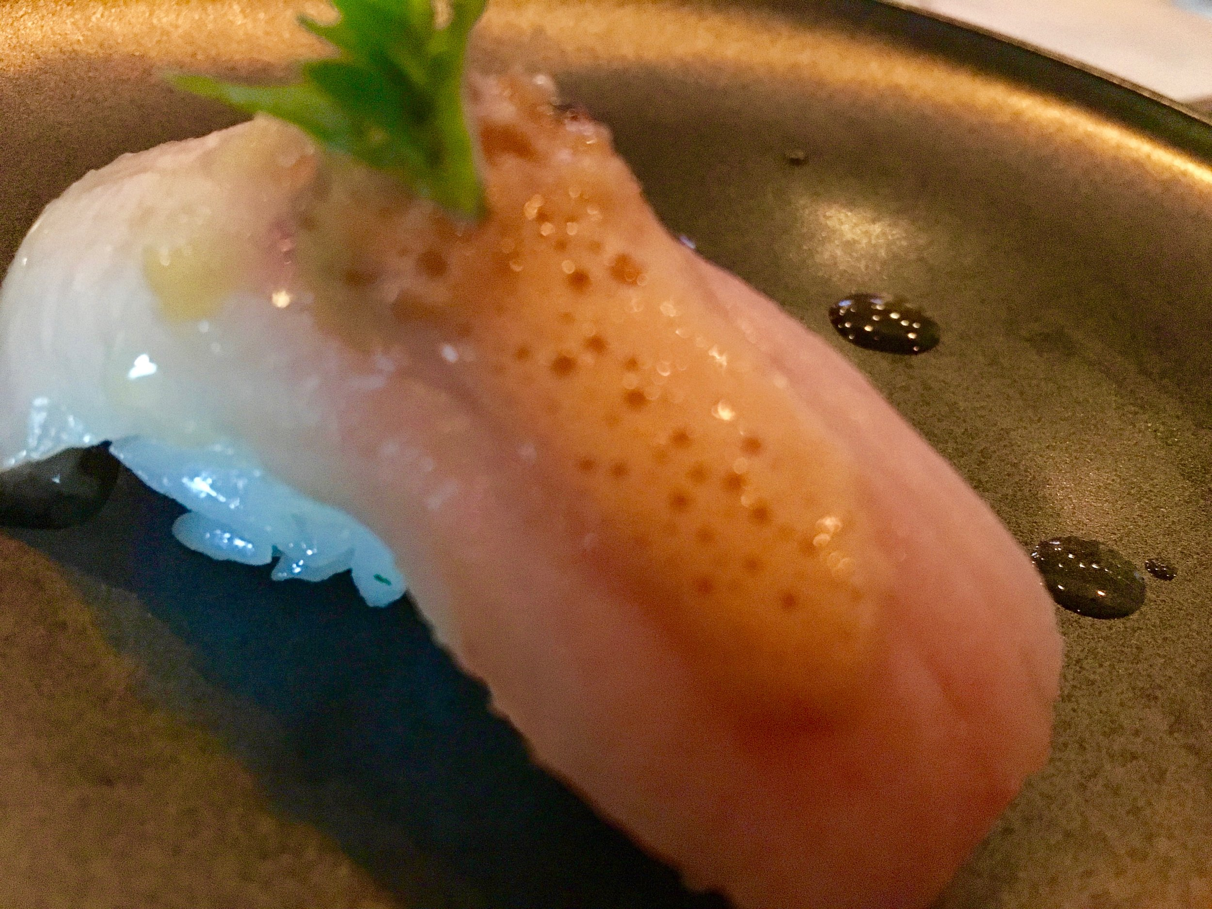 Yellowtail belly nigiri with bourbon barrel-aged soy, lemongrass pesto, uni foam and globe basil at the omakse dinner at Seito Sushi
