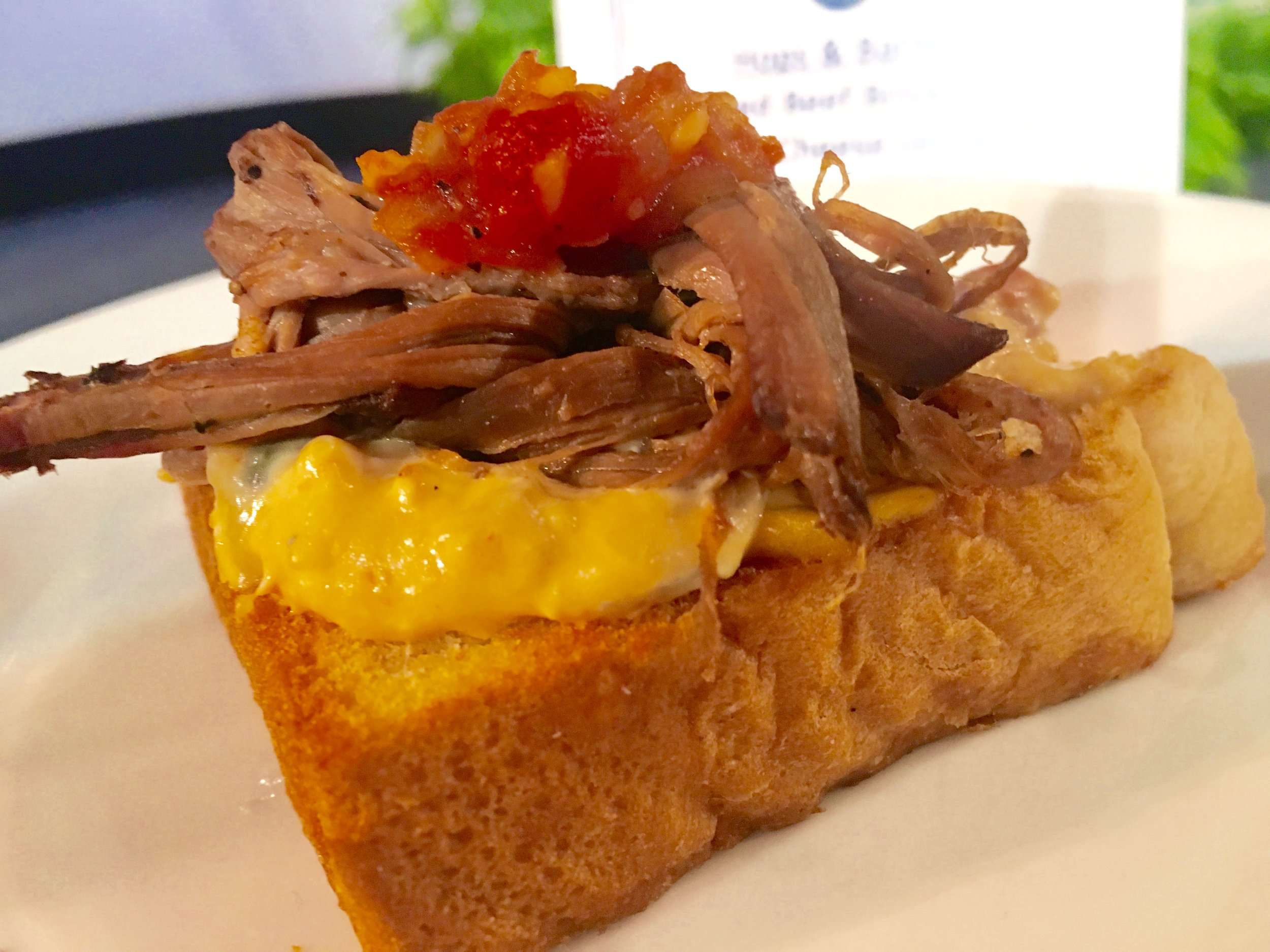 smoked beef brisket with pimiento cheese and garlic toast Best New Dishes at Epcot Food and Wine Festival 2016