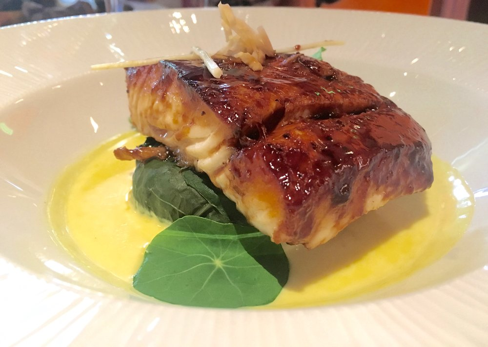 "Hoisin-glazed halibut with ""forbidden"" rice, swiss chard and turmeric sauce at Tiffins"
