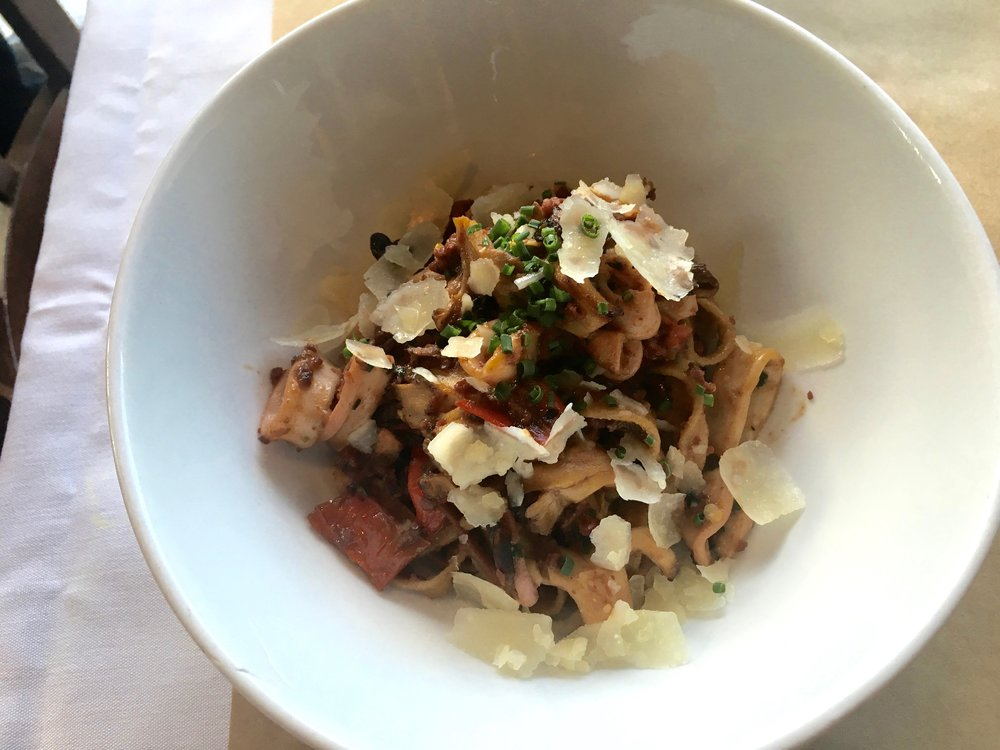 Porcini tagliatelle (pasta) with salumi Bolognese, braised squid, charred peppers, maitake mushrooms and Parmesan cheese at The Ravenous Pig for Visit Orlando Magical Dining Month 2016