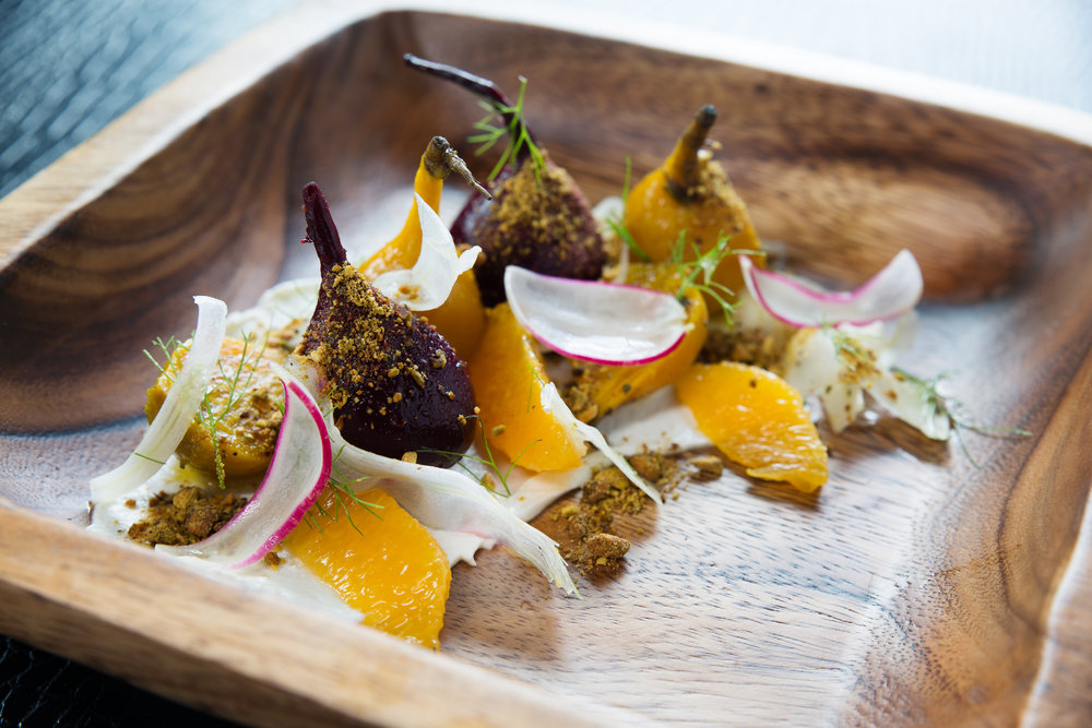 Roasted baby beets with orange, pistachio and goat cheese