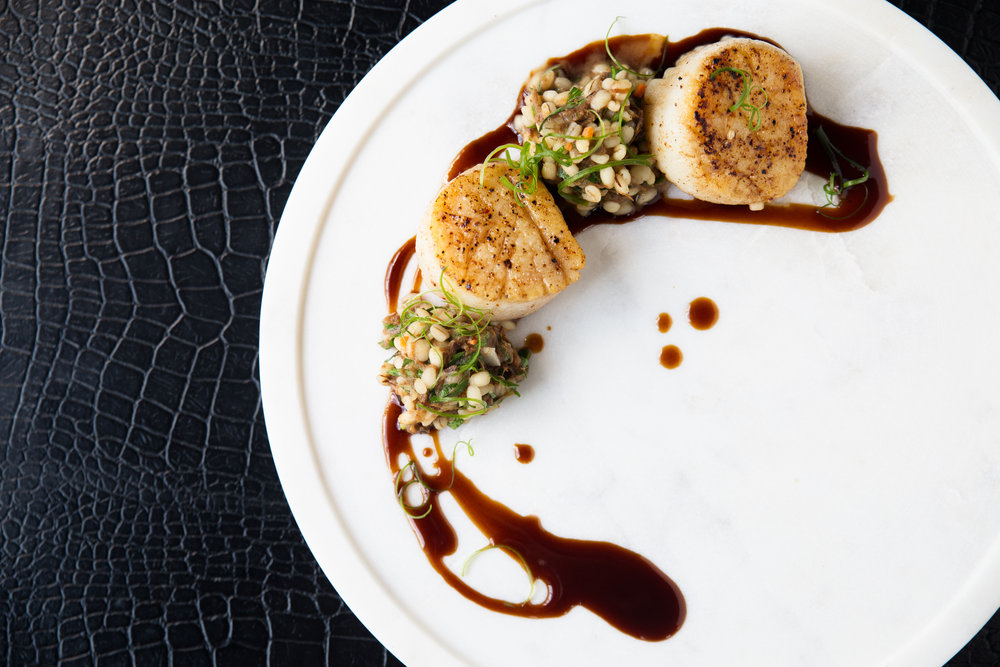 Seared scallops with short rib, barley risotto and red wine sauce