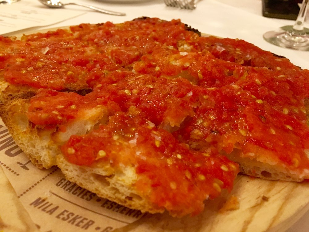 I can't find this on the menu but I'm sure it's there. It's thin bread, coated I believe with olive oil, then topped with garlicky crushed tomatoes. Nibbled with a glass of Rioja, this is a real treat.