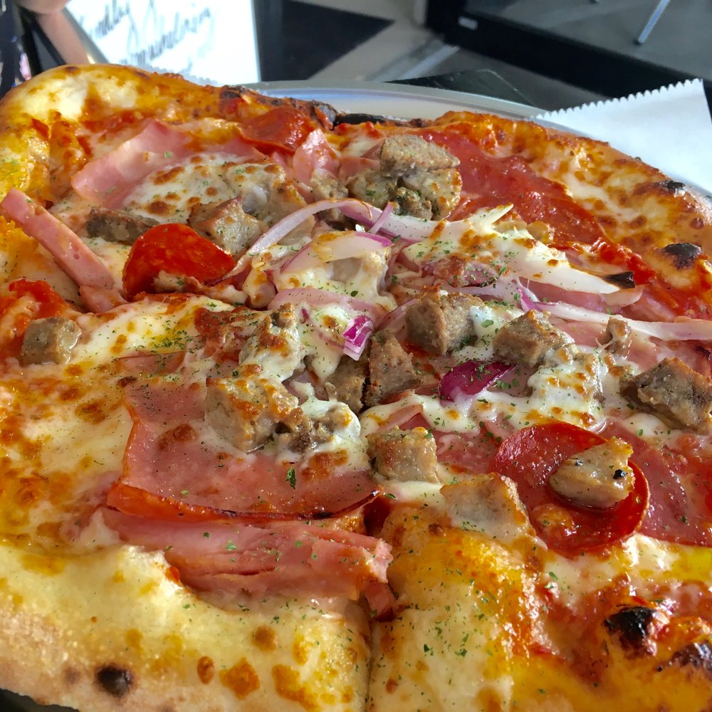 The Meat Lovers Roman-style pizza at The Pie Orlando is my favorite of the three. It's topped with a fennel-laced sausage, generous slivers of smokey ham (it's described on the menu as prosciutto but tastes different than usual), thin slices of pepperoni and bits of red onion.