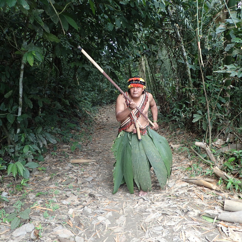Juan is an educated, eloquent Ecuadorian tour guide who donned his native dress for Adventures by Disney travelers, then demonstrated how to use a blowgun.