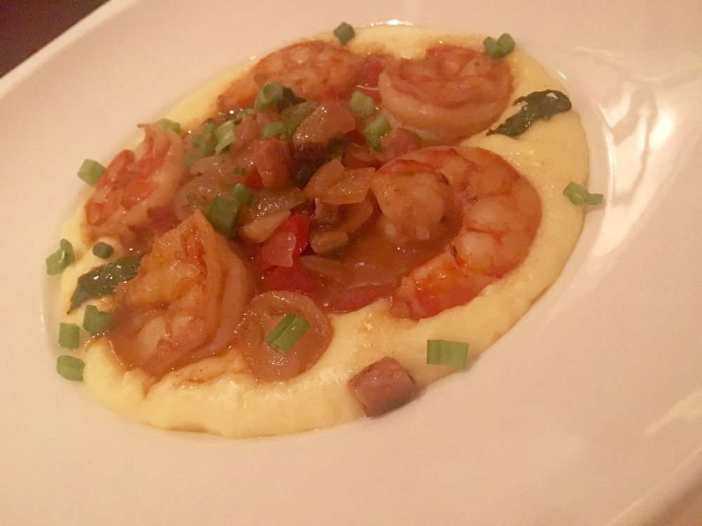 The shrimp are exceptionally flavorful, the grits creamy with cheddar cheese, at Capital Grill.