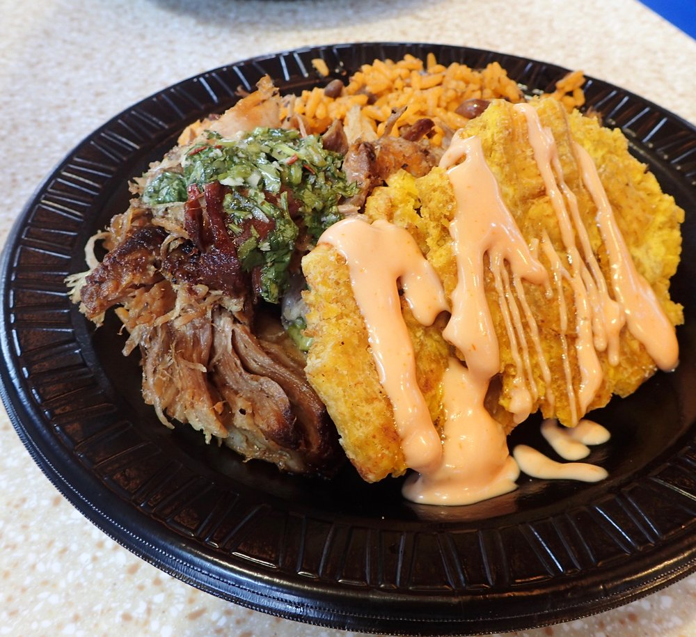 This is lechón asado ($11) -- traditionally roasted pork. That orange spicy mayo on the tostones (fried green plantain) adds zest. I'd request extra.