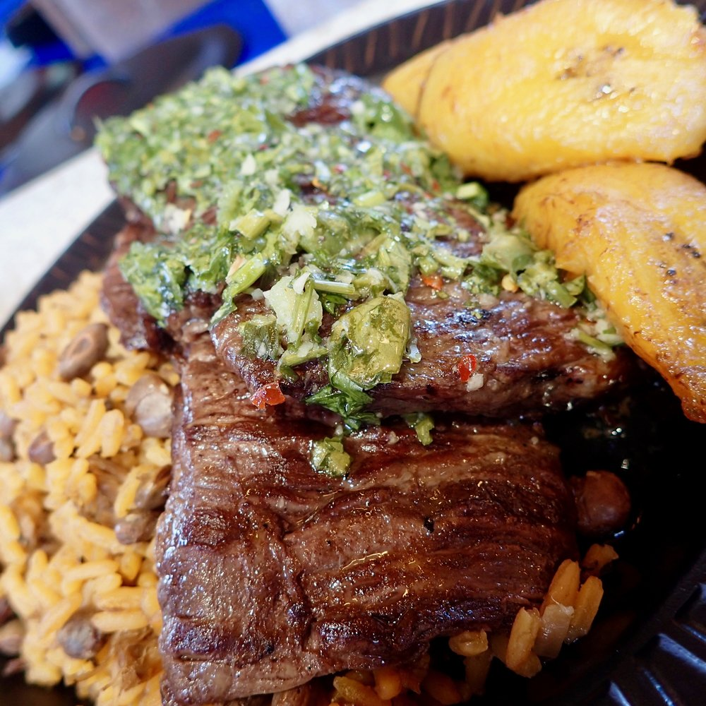 No kidding, I would seriously consider returning to the SeaWorld Seven Seas Food Festival just to get more of this marinated and grilled steak topped with chimichurri sauce. It's called churrasco ($13). That's rice to the left, sweet plantains to the right.
