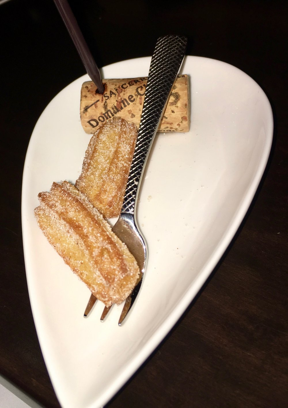 Another play on California Disneyland food: churro with Mexican chocolate sauce served squeeze-it-yourself style and planted in a cork