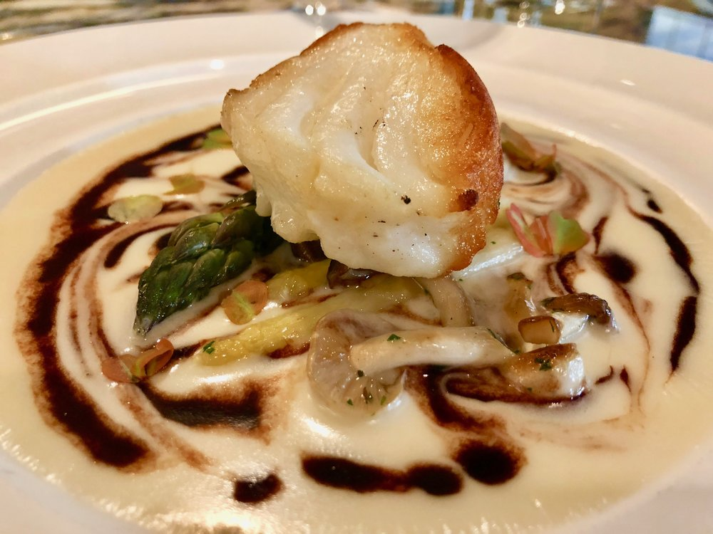 Chilean sea bass with an insanely silky potato base with mushrooms and asparagaus