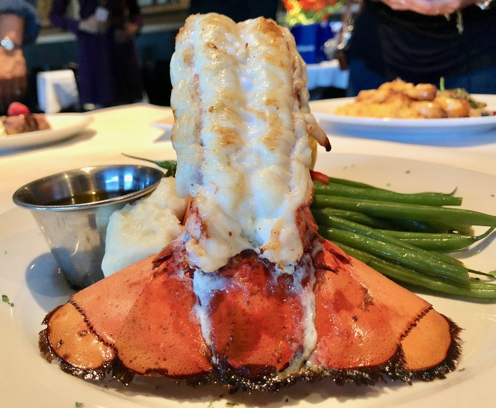 The star: Big Fin's broiled Maine lobster tail with garlic mashed potatoes and French-style green beans. It's one of four entree choices on the restaurant's Magical Dining menu for 2018.