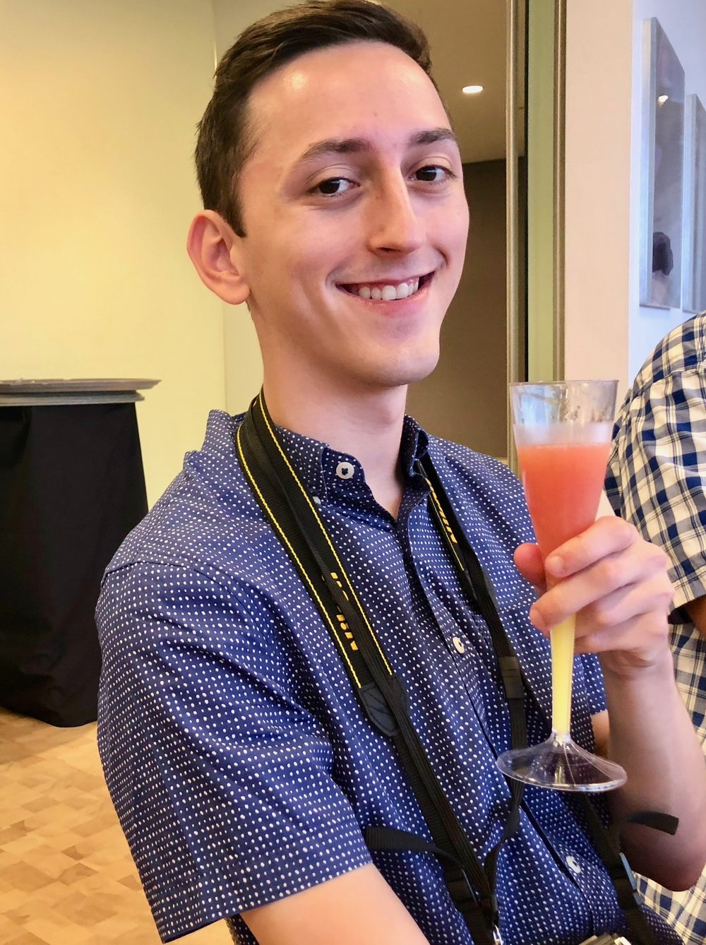 Sampling mimosas from the 2108 Epcot Food & Wine Festival's Shimmering Sips Mimosa Bar. This red-hued variety is the Madras mimosa.
