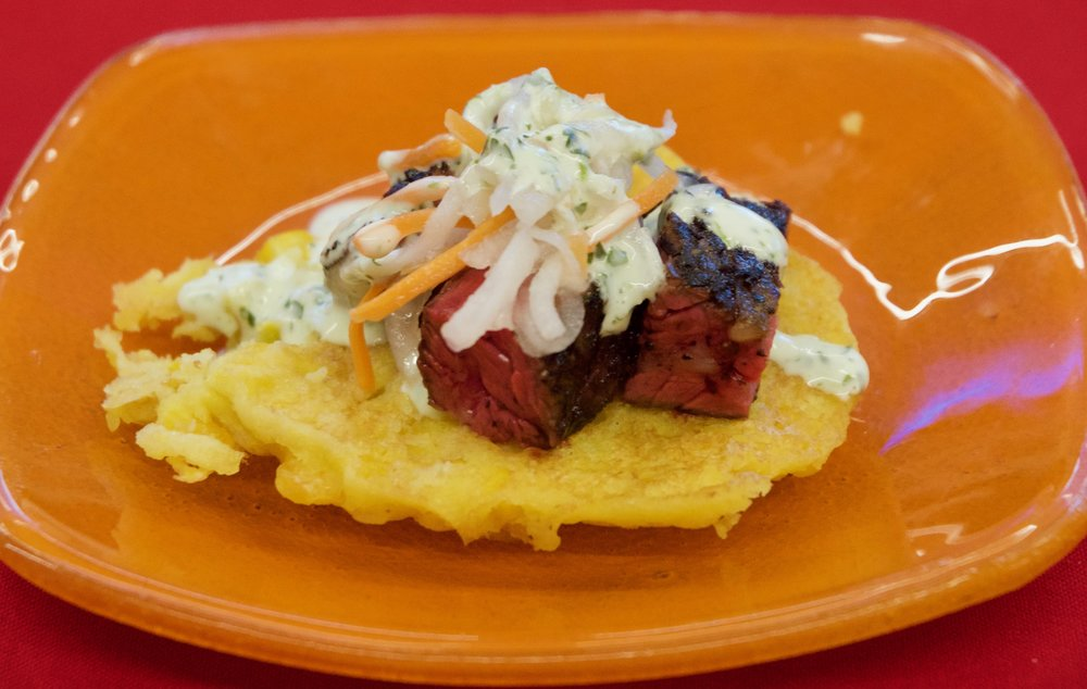 Charred chimichurri skirt steak on a smoked corn cake