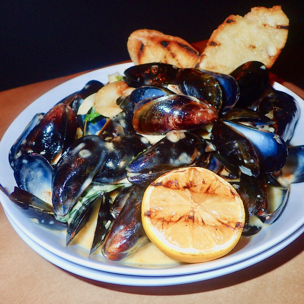 Mussels with a lemon white wine sauce and basil at Sette Orlando