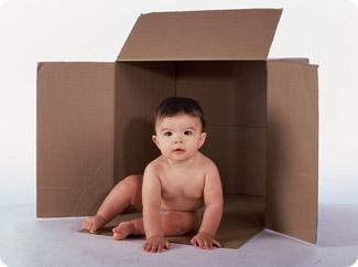 Baby and cardboard box